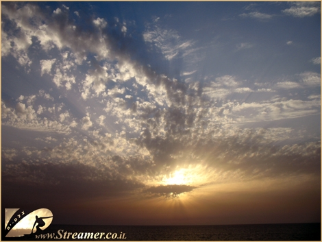 The sun is hiding behind the clouds, sending deep golden rays into the sky... Ashqelon May 08