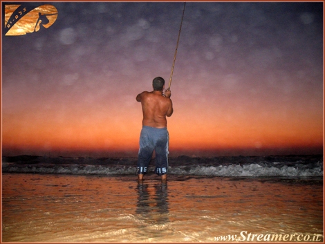 It's after sunset and the sun is doing it's way to the other side of the globe. The fishermens is enjoying spactacular moments. Gute beach Ashqelon Sep 08