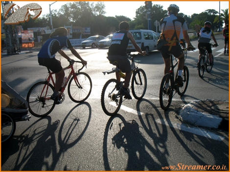 Bycicle and Shadows... On the road the Cyclists must be seen and respected. Critical Mass is touring Ashqelon Oct. 08. Watch the photos on Gallery and The clip on the Daily Show