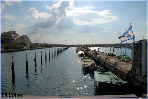Noon time at Marina Ashqelon. Glittering Sparks of light on the water all along the pier and deapth of the image - Oct. 08