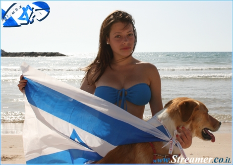 Isreal celebrated Independence day... remember? - Beutiful Vika is holding a flag and a dog in the other habd... don't ket him get away:-)