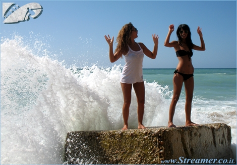 Lian and Ariela, 2 local babes, are modelling while standing on a rock. The camera caught the moment when the wave brakes on the rock leaving the 2 ladies raising their hands in surrender... ! Nothing to worry about. The girls are safe but got really wet...:)