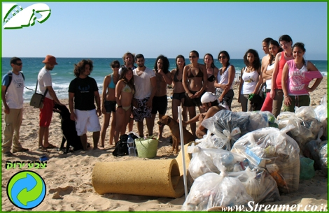 "<strong><font color=""#008000"">A huge cleaning project took place at North shore Ashqelon Friday 05.06.,The sea turtles can be relax for the time being:-) In this photo appearing half of the volonteers of the project and a quarter of the amunt of garbage bags the where collect by them. click here to watch <a href=""http://streamer.co.il/gallery/cat/beach_clean-up_initiative_at_north_shore__5__6__9/"">Photos</a> and <a href=""http://streamer.co.il/live/?file_id=398"">clip</a> and clips will be available tomorow - Respect to thos eone of a kind people that cherrish and carefor their envoirment.</font></strong>"