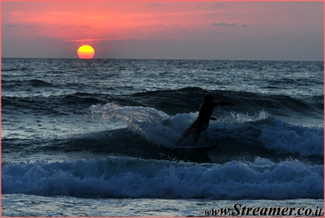 The last and most beutifull moments of the day... Surf until it's dark :-) Redish Sunset at Yamia beach Ashqelon July 09