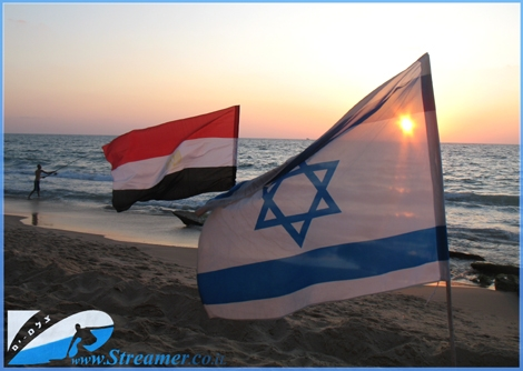 "Flag beach of Ashqelon - Streamer's enviormental activists cleaned the beach  of Gute on a daily base and placed flags all along the strech of beach  - click here to <strong><a href=""http://streamer.co.il/news/view/128/"">read Article</a></strong>, watch<strong> <a href=""http://streamer.co.il/gallery/cat/flags_and_bins_at_gute_beach_-_aug__9/#"">photo gallery</a> </strong>and <strong><a href=""http://streamer.co.il/live/"">Video Clip</a></strong>"