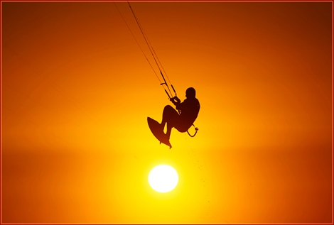 """<div align=""""center""""><strong>The Golden Hour - Kitesurfer in air action. A great ball of fire... - Ashqelon, Israel Sep 09<br /></strong></div>"""