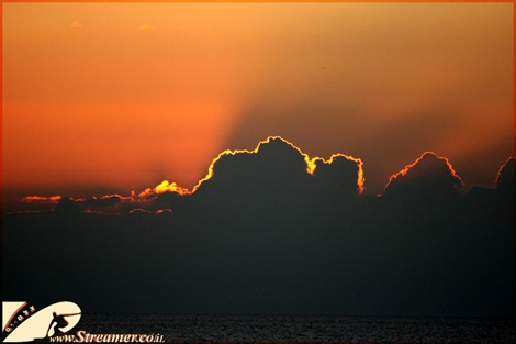 "<div align=""center""><font color=""#333333""><strong>Sunset on a cloudy horizon. the ray of lights collors the clouds with a bright line. The mediterranean Dec 09</strong></font><br /></div>"