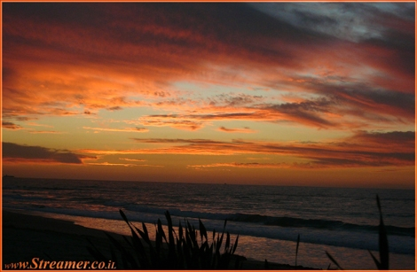 Mediterranean sunset.. The collors of the sky are in the red shades of life... - Palmahim beach January 2010