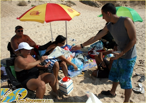 "<div align=""center""><font color=""#008000""><strong>Streamer's Green Beach initiative volunteers are handing garbage bags and disposal ashtrayers to the people on the beach, Saturday August 14th 2010. Click on main photo to watch the photo gallery and Click here to <a href=""http://streamer.co.il/news/view/183/"">watch the coverage clip</a></strong><br /></font></div>"