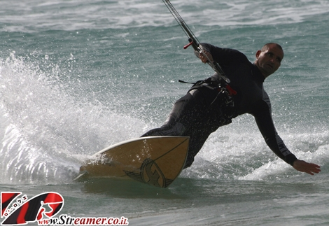 "<font color=""#333333""><strong>Take a surfboard attach it to a kite and what you got...? <font color=""#ff0000"">Moshe Cohen</font>:) A real free style kite surfer from Ashqelon. <strong>Click on main photo to watch the albums from 26+27 Jan 2011</strong></strong></font>"