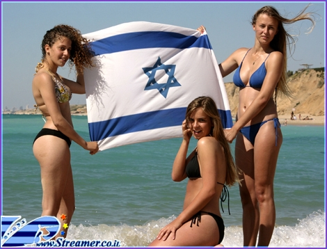 "<font color=""#333333""><strong>The essence of beauty in Israel reflects by these three amzing girls holding the Israeli flag at the beach of Ashqelon. click on main photo to watch the HOT gallery...:-)</strong></font>"