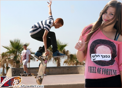 """<font color=""""#333333""""><strong>Thumbs up for the """"Grab Tail"""" of local skateboarder <font color=""""#FF0000"""">Evyatar Eshkar</font>. Click on mian photo to watch the album of the new skateboard generation in Skatepark Ashqelon May 20th 2011</strong></font>"""