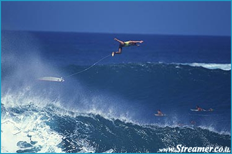 "<font color=""#003366""><strong><font color=""#FF0000"">Bailing out from a massive wave in Hawaii?!</font> 40 years ago the surfer had to swim back to shore to get his board back...! Now days, The surfboard's leash is a basic surfing accesory. All about the leash <a href=""http://streamer.co.il/articles/view/111/"">in the next article</a></strong></font>"