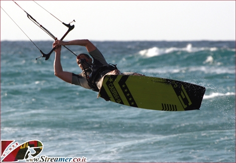 "<font color=""#003366""><strong><font color=""#FF0000"">Gili Cohen</font> is the  youngest of three brothers, Pioneers of kite surfing in Ashqelon.  Aquiped with great style and talent, each time he goes surfing he spend  more time in the air... Click on main photo to watch the kite surfing  album from Oct 28th 2011</strong></font>"