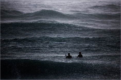 "<font color=""#003366""><strong>After sunset and heavy rain at the beach of  Ashqelon. <font color=""#b70000"">Amir Cohen</font>, &quot;Rauiters&quot; photographer, captured a magnificent  moment it time where two surfers sit in the washing rain waiting for the  next big wave. <a href=""http://totallycoolpix.com/2012/02/coolest-pix-of-2012-week-05/"" target=""_blank"">This photo was published in the New York Times</a> on February 2012. Respect</strong></font><br />"