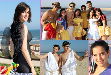 "<font color=""#003366""><strong>Fairy, Police woman,  Tinkerbell and roman guys... This is not a start of a joke but some  creative costumes of happy people at the local beach of Ashqelon. Click on main photo to watch the colorful album from Purim Holiday <a href=""http://streamer.co.il/gallery/cat/purim_at_the_beach_-_19__3_2_11/#"">06.03.2012</a> - <font color=""#b700b7"">Happy Purim</font> :-)</strong></font>"
